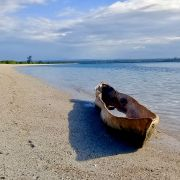 Tradition swahili canoe on the white sand beach at the ocean limit in daylight at Mgao beach in mtwara south tanzania