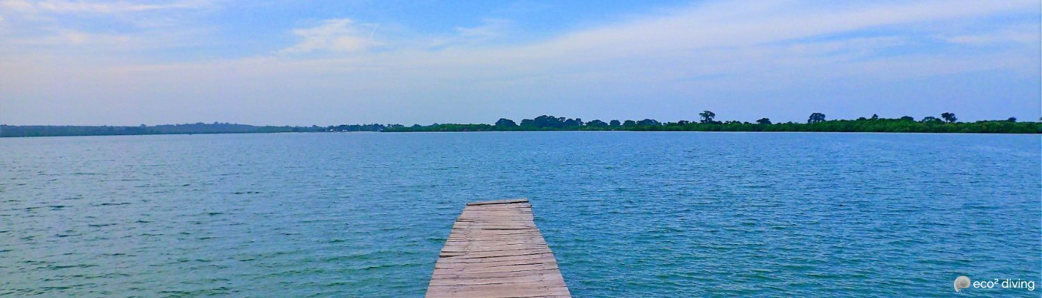 Wooden pontoon facing the ocean with land in horizon for beginner divers at Mikindani Bay Yacht Club in Mtwara Tanzania