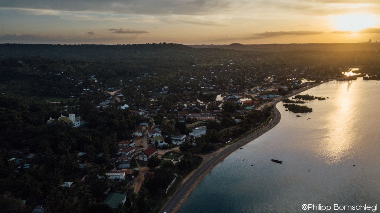 Drone sky view of Mikindani swahili coastal village all along the ocean during the sunset in Mtwara Tanzania